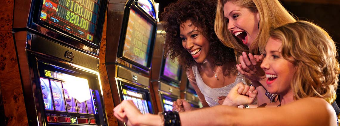 Women playing at slot machines
